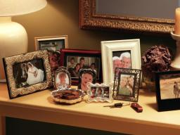 ts-78486658_collection-of-framed-pictures-on-console_s4x3-jpg-rend-hgtvcom-966-725